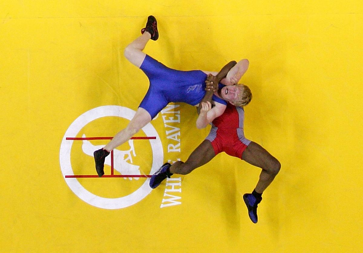 T.C. Dantzler (red) throws Cheney Haight (blue) in the Greco-Roman 74kg division championship match during the USA Olympic trials for wrestling and judo on June 14, 2008