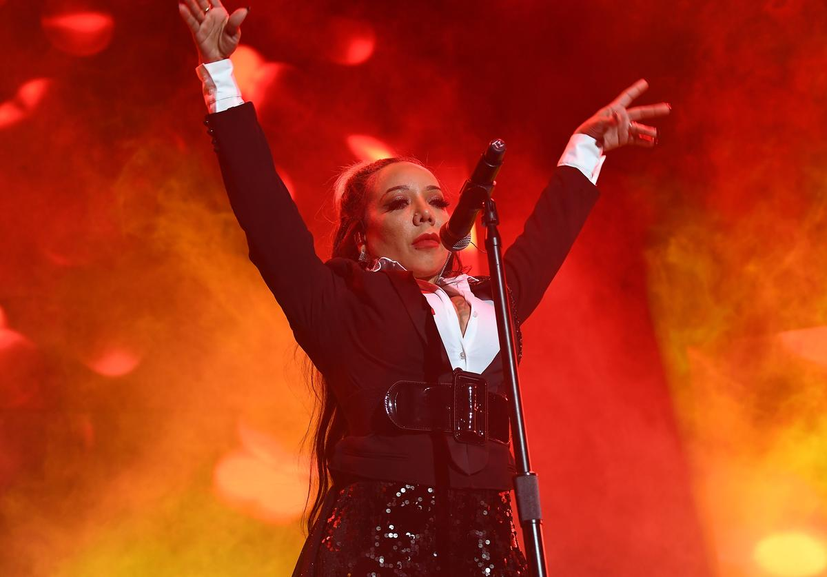 """Tameka """"Tiny"""" Harris of Xscape performs in concert during So So Def 25th Cultural Curren$y Tour at State Farm Arena on October 21, 2018 in Atlanta, Georgia"""