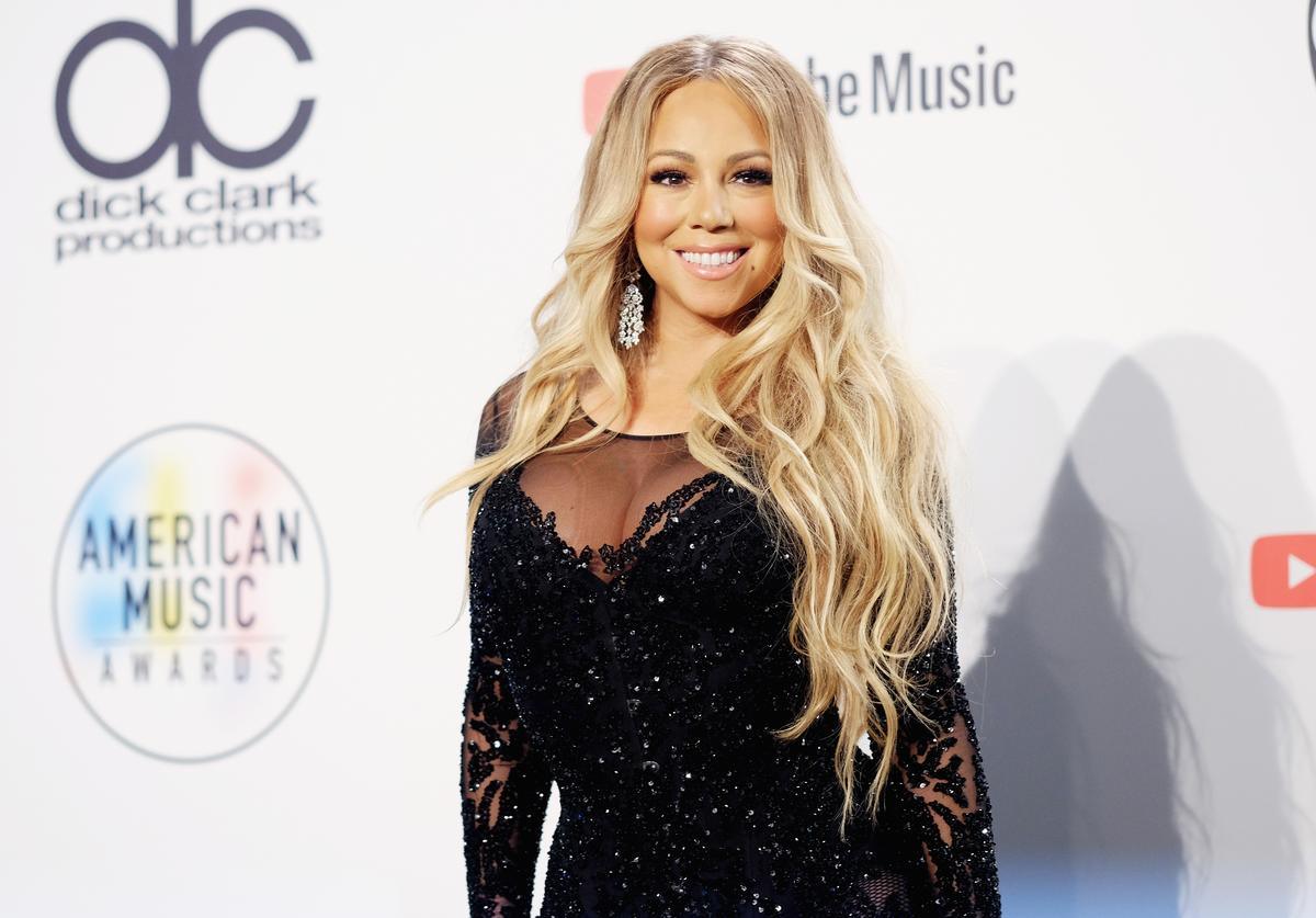 Mariah Carey poses in the press room during the 2018 American Music Awards at Microsoft Theater