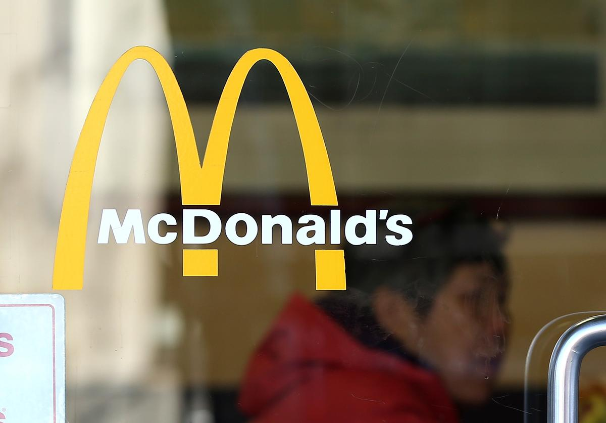 The McDonald's logo is posted in the window of a McDonald's restaurant on March 12, 2013 in San Francisco, California. McDonald's has retained its number one ranking in both global and domestic sales and continues to be the largest single restaurant brand in the world with company-store sales last year of $4.53 billion and franchise-store sales of $31.063 billion for a domestic total of $35.59 billion.