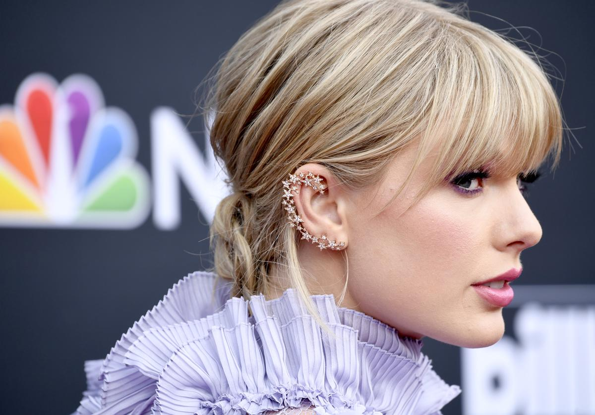 Taylor Swift, hair, earring, and fashion detail, attends the 2019 Billboard Music Awards