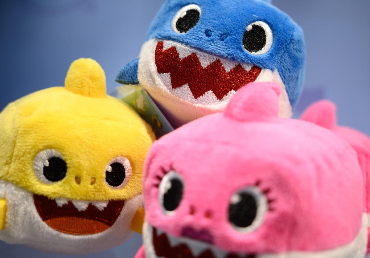 """A selection of """"Baby Shark"""" toys are seen on a display at the annual """"Toy Fair"""" at Olympia London on January 22, 2019 in London, England."""