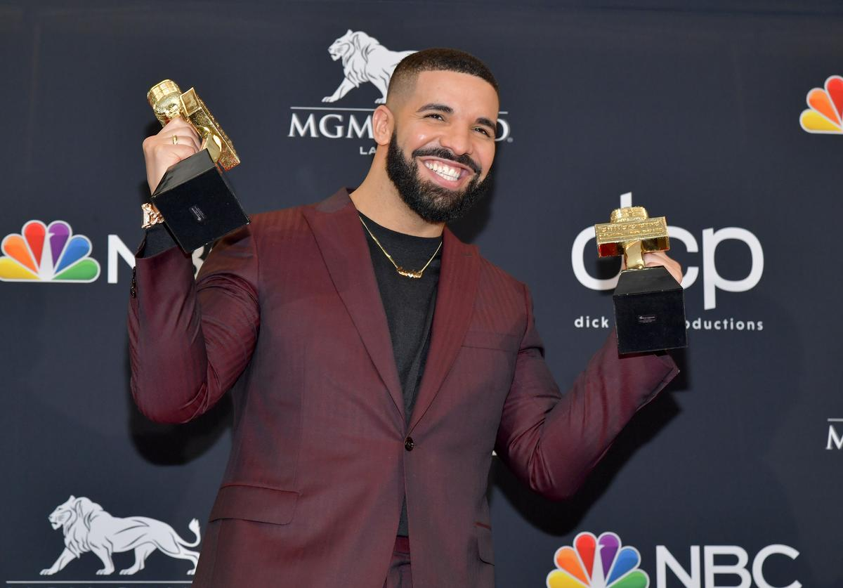 "Drake poses with the awards for Top Artist, Top Male Artist, Top Billboard 200 Album for ""Scorpion"", in the press room during the 2019 Billboard Music Awards at MGM Grand Garden Arena on May 01, 2019 in Las Vegas, Nevada"