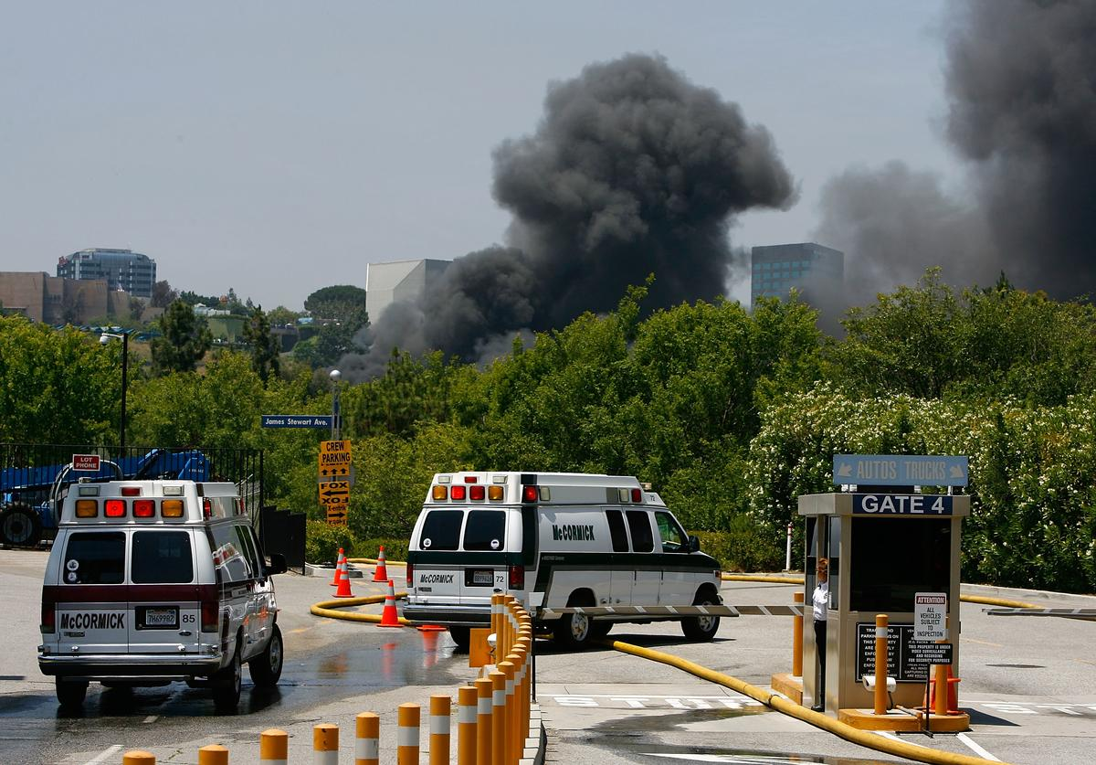 Ambulances enter Gate Four after four firefighters had reportedly been evacuated with injuries while battling a huge fire on the backlot of Universal Studios on June 1, 2008 in Universal City, California