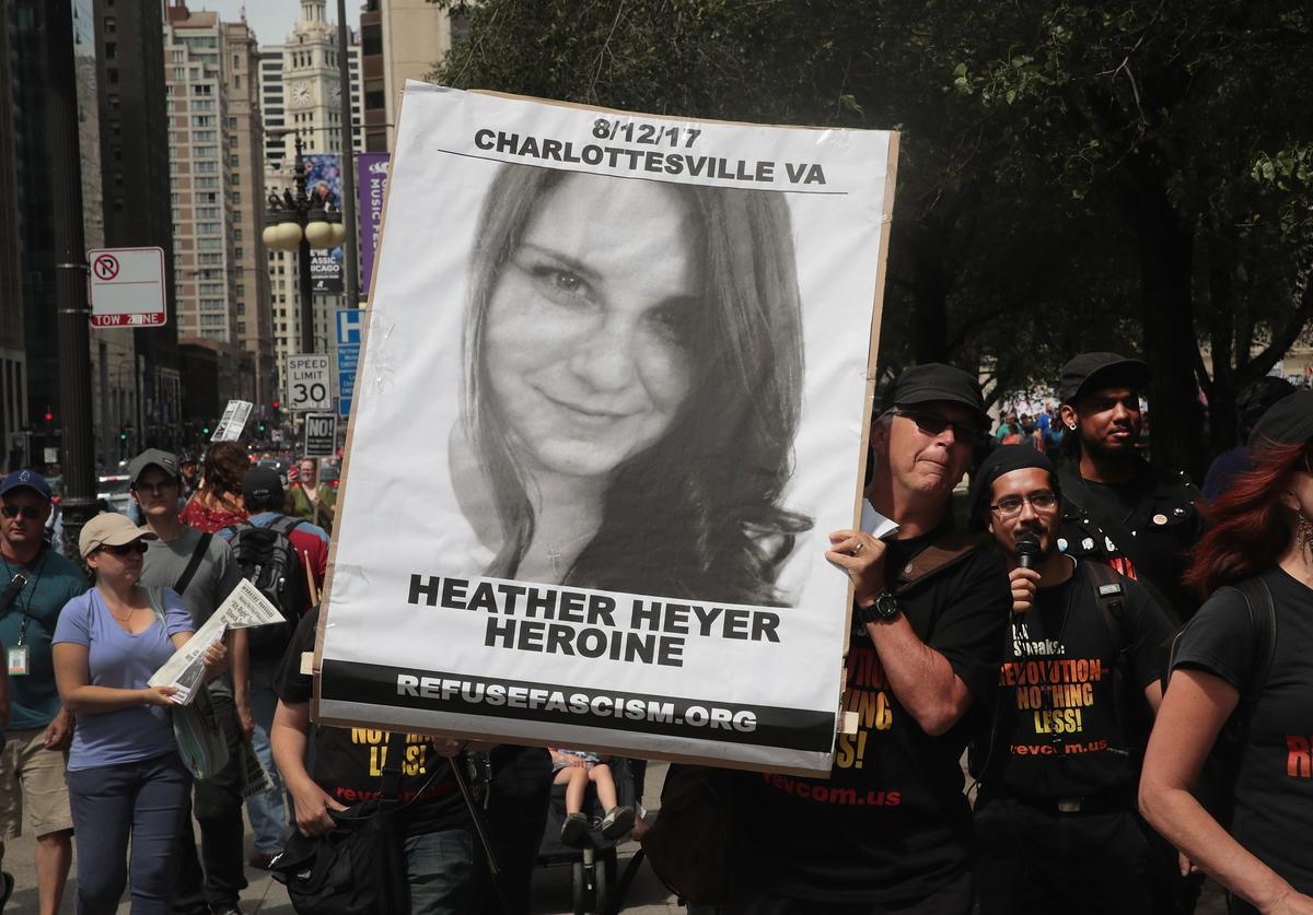 A demonstrator carries a sign remembering Heather Heyer during a protest on August 13, 2017 in Chicago, Illinois. Heyer was killed and 19 others were injured yesterday in Charlottesville, Virginia when a car plowed into a group of activists who were preparing to march in opposition to a nearby white nationalist rally. Two police officers were also killed when a helicopter they were using to monitor the rally crashed.