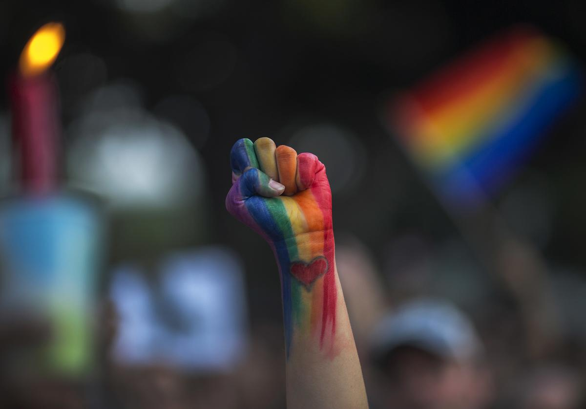 A defiant fist is raised at a vigil for the worst mass shooing in United States history on June 13, 2016 in Los Angeles, United States.
