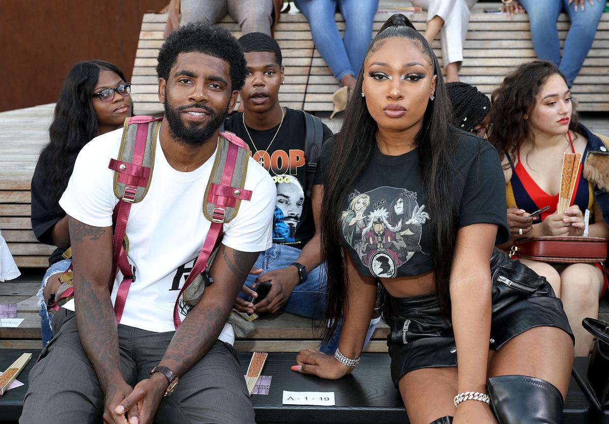 Kyrie Irving and Megan Thee Stallion attend the front row for Coach 1941 during New York Fashion Week on September 10, 2019 in New York City