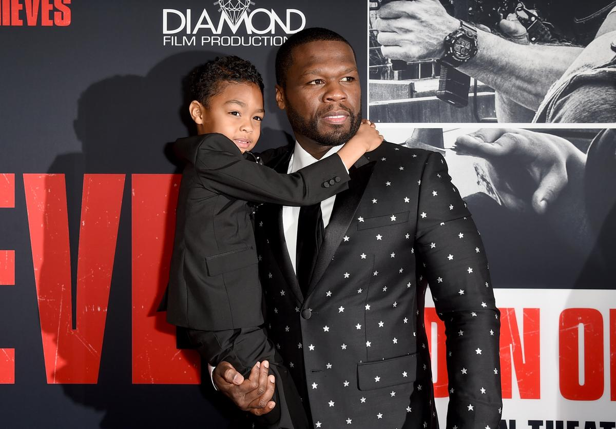 """50 Cent (R) and Sire Jackson attend the premiere of STX Films' """"Den of Thieves"""" at Regal LA Live Stadium 14 on January 17, 2018 in Los Angeles, California"""