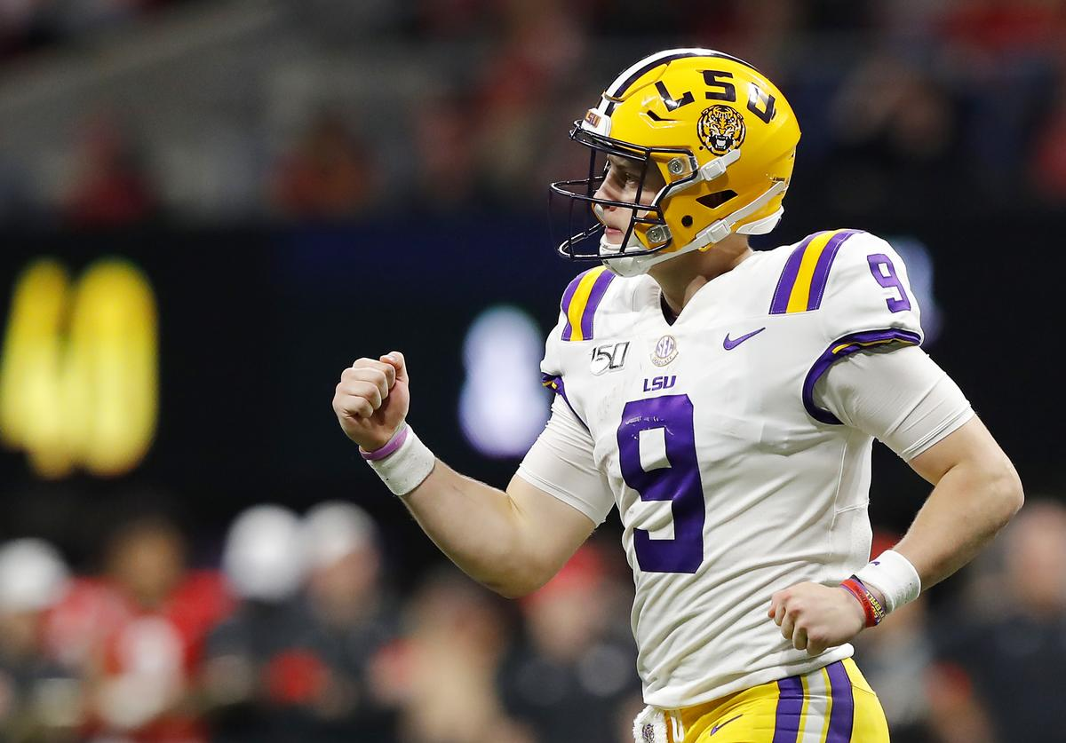 Joe Burrow #9 of the LSU Tigers celebrates after throwing a touchdown pass to Terrace Marshall Jr. #6 (not pictured) in the third quarter against the Georgia Bulldogs during the SEC Championship game at Mercedes-Benz Stadium on December 07, 2019 in Atlanta, Georgia.