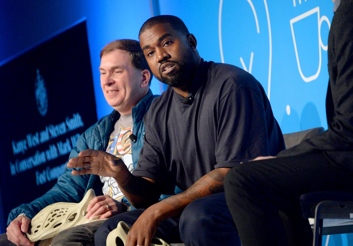 """Steven Smith and Kanye West speak on stage at the """"Kanye West and Steven Smith in Conversation with Mark Wilson"""" at the on November 07, 2019 in New York City"""