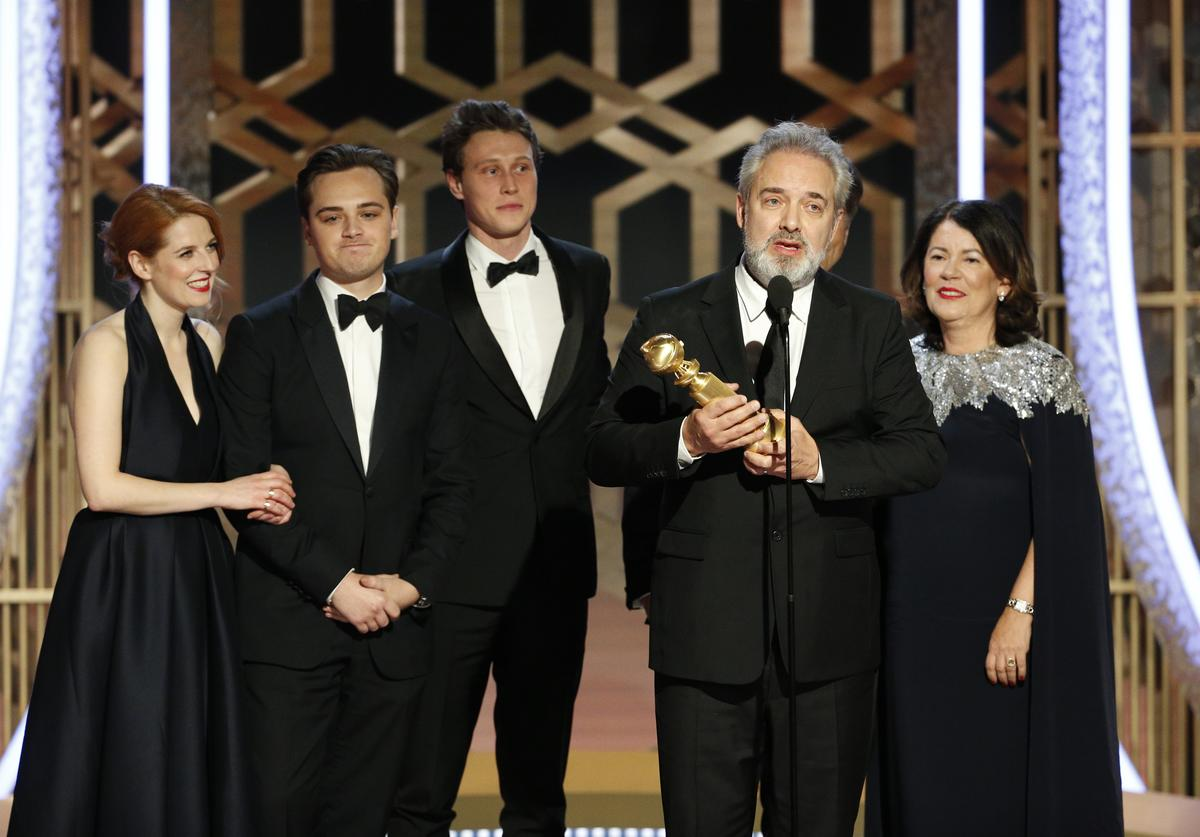 """In this handout photo provided by NBCUniversal Media, LLC, Sam Mendes accepts the award for BEST MOTION PICTURE - DRAMA for """"1917"""" onstage, with Dean-Charles Chapman, George MacKay and Pippa Harris, during the 77th Annual Golden Globe Awards at The Beverly Hilton Hotel on January 5, 2020 in Beverly Hills, California."""