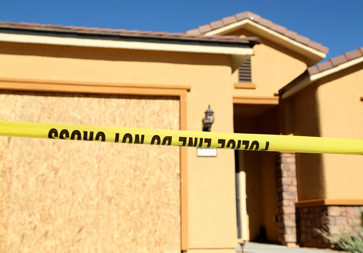 Police tape lines the driveway in front of the house in the Sun City Mesquite community where suspected Las Vegas gunman Stephen Paddock lived, October 2, 2017 in Mesquite, Nevada. Paddock allegedly opened fire from a room on the 32nd floor of the Mandalay Bay Resort and Casino onto the Route 91 music festival in Las Vegas, leaving at least 58 people dead and over 500 injured. According to reports, Paddock killed himself at the scene.