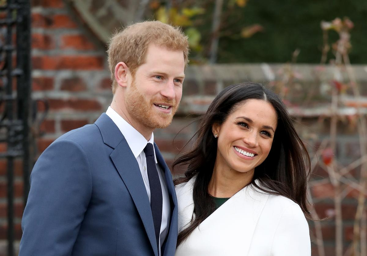 Prince Harry and actress Meghan Markle during an official photocall to announce their engagement at The Sunken Gardens at Kensington Palace on November 27, 2017 in London, England.