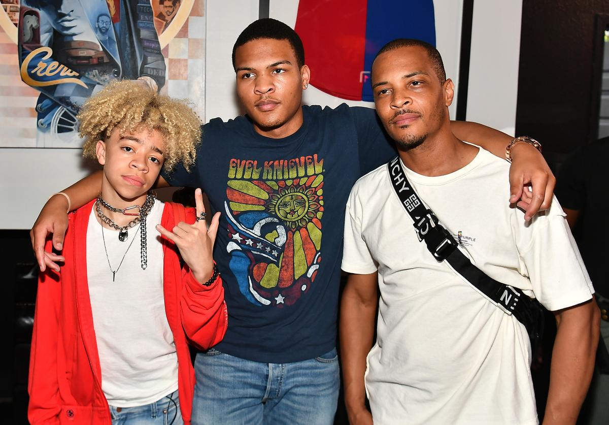 King Harris, Messiah Harris, and T.I. attend the Nipsey Hussle Exhibit Unveiling at The Trap Music Museum on August 13, 2019 in Atlanta, Georgia