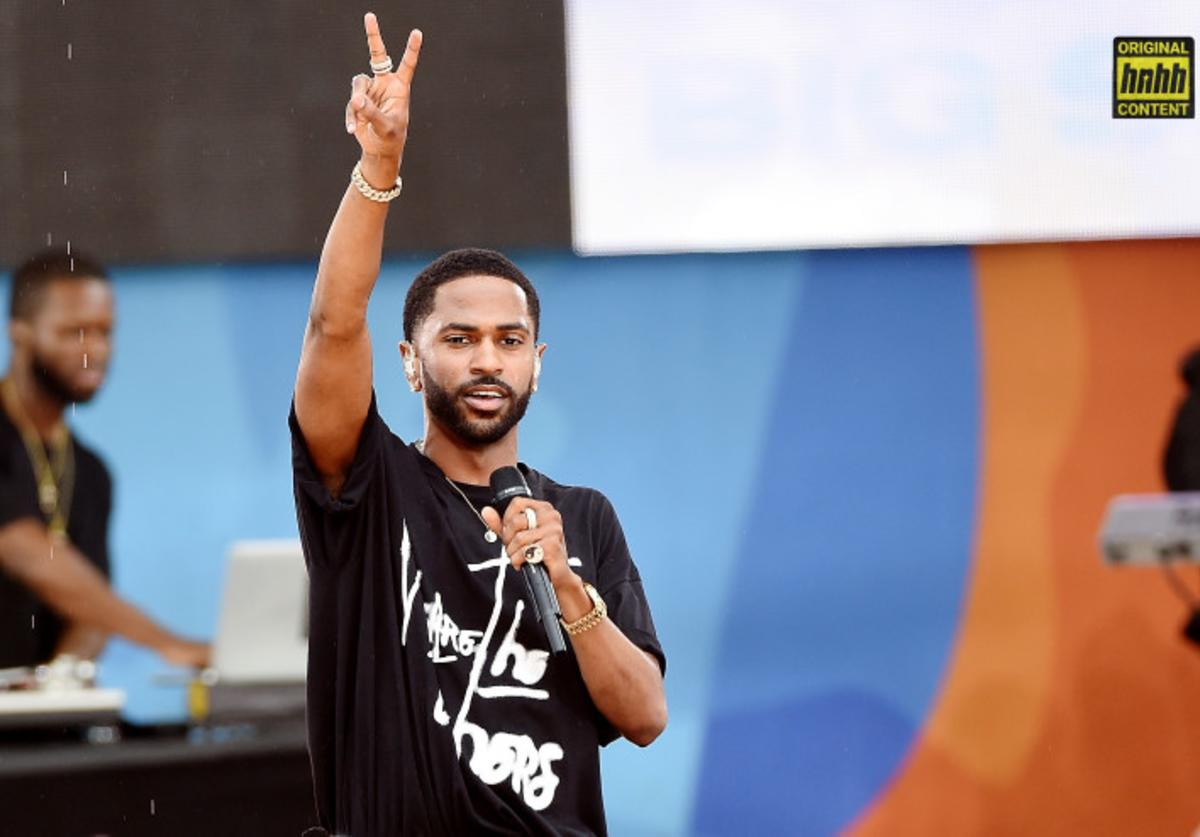 Big Sean throws up the peace sign