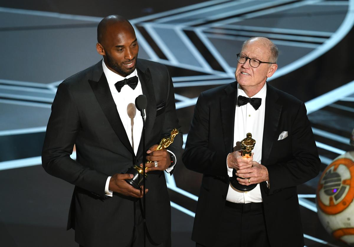 Filmmakers Kobe Bryant (L) and Glen Keane accept Best Animated Short Film for 'Dear Basketball' onstage during the 90th Annual Academy Awards at the Dolby Theatre at Hollywood & Highland Center on March 4, 2018 in Hollywood, California
