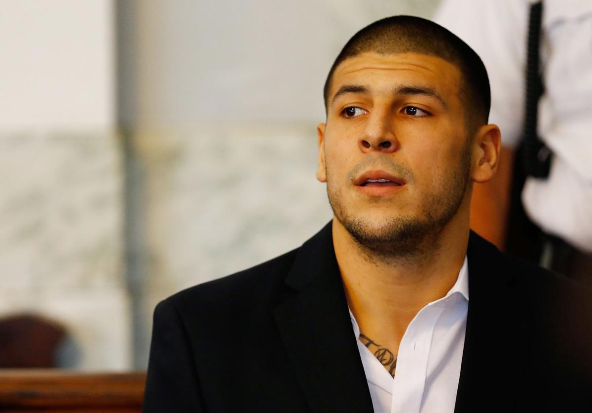 Aaron Hernandez sits in the courtroom of the Attleboro District Court during his hearing on August 22, 2013 in North Attleboro, Massachusetts. Former New England Patriot Aaron Hernandez has been indicted on a first-degree murder charge for the death of Odin Lloyd.