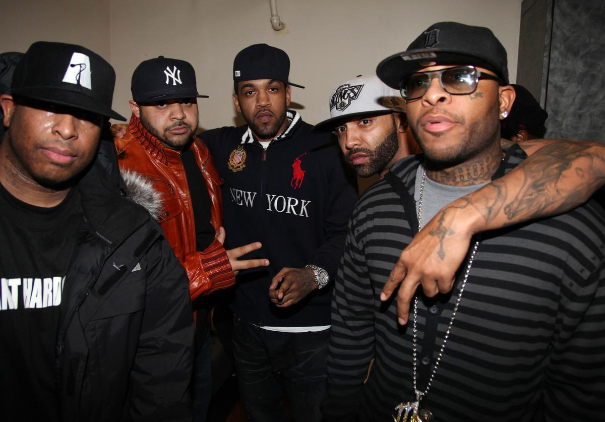 """DJ Premier, Joell Ortiz, Lloyd Banks, Joe Budden, and Rocye Da 5'9"""" pose for a picture backstage at the Highline Ballroom on February 8, 2011 in New York City"""
