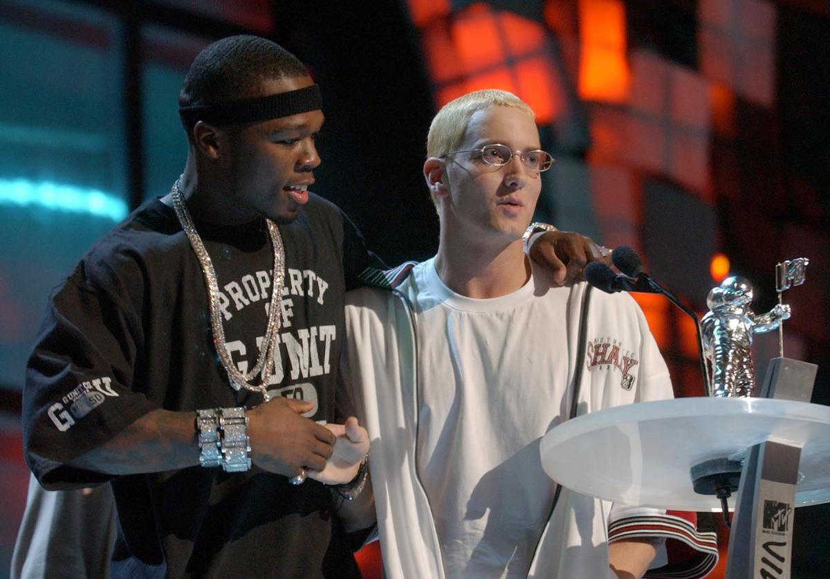 50 Cent(L) and Eminem speak onstage during the 2003 MTV Video Music Awards at Radio City Music Hall on August 28, 2003 in New York City