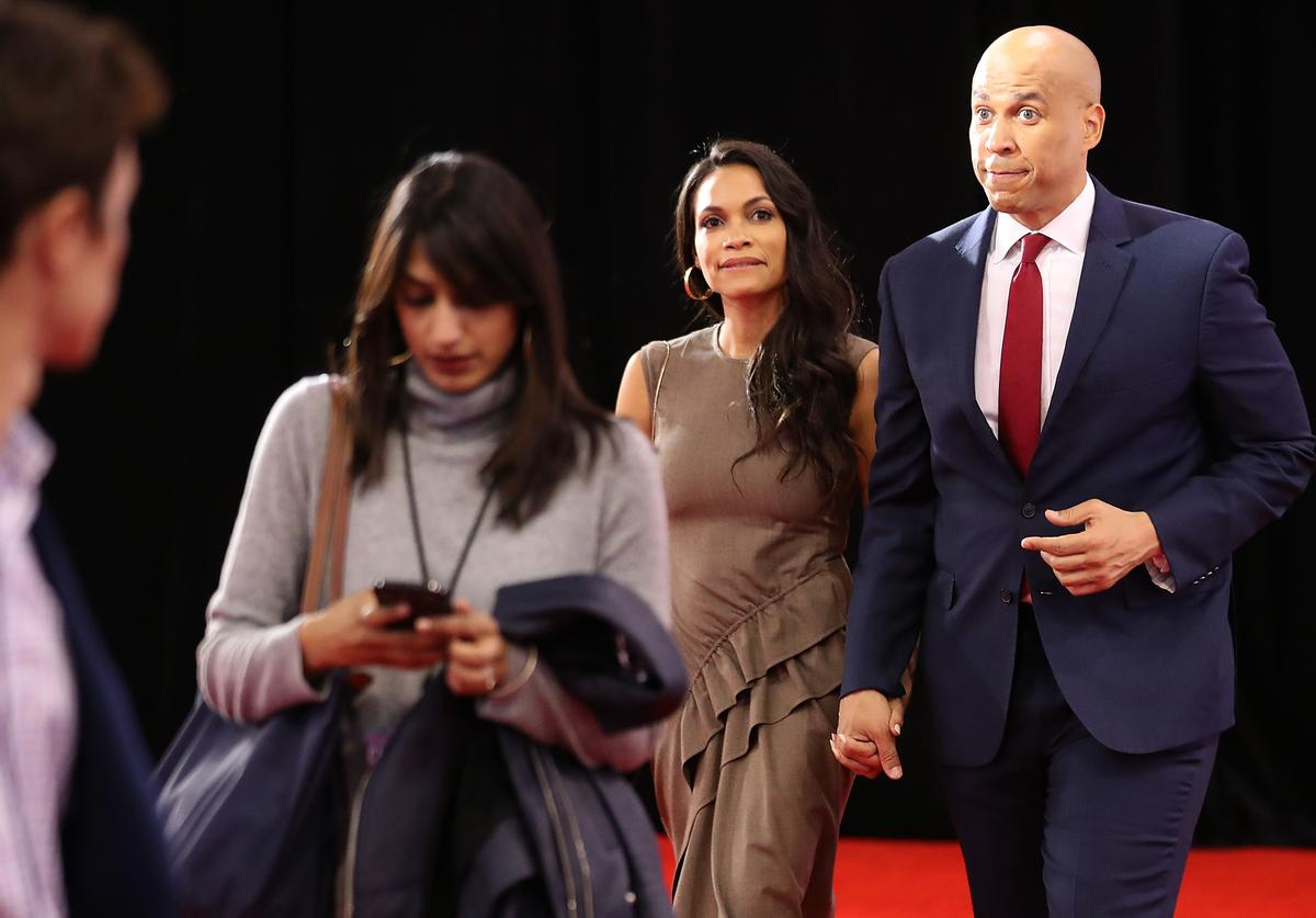 Cory Booker (D-NJ) enters the Spin Room with his girlfriend Rosario Dawson after the Democratic Presidential Debate (Oct. 2019)