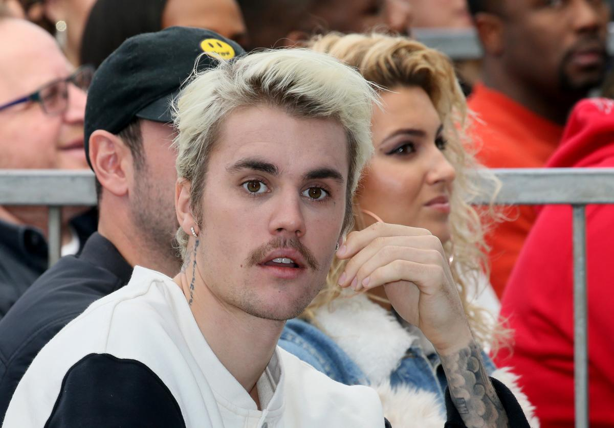 Justin Bieber (L) and Tori Kelly (R) attend an event honoring Sir Lucian Grainge with a star on the Hollywood Walk of Fame on January 23, 2020 in Hollywood, California