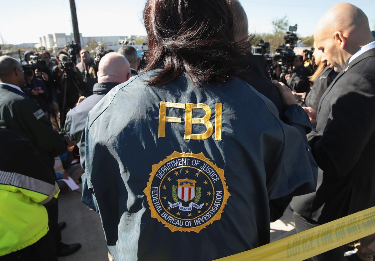 FBI and ATF agents, and local officials update the media on their investigation outside a FedEx facility (March 2018)