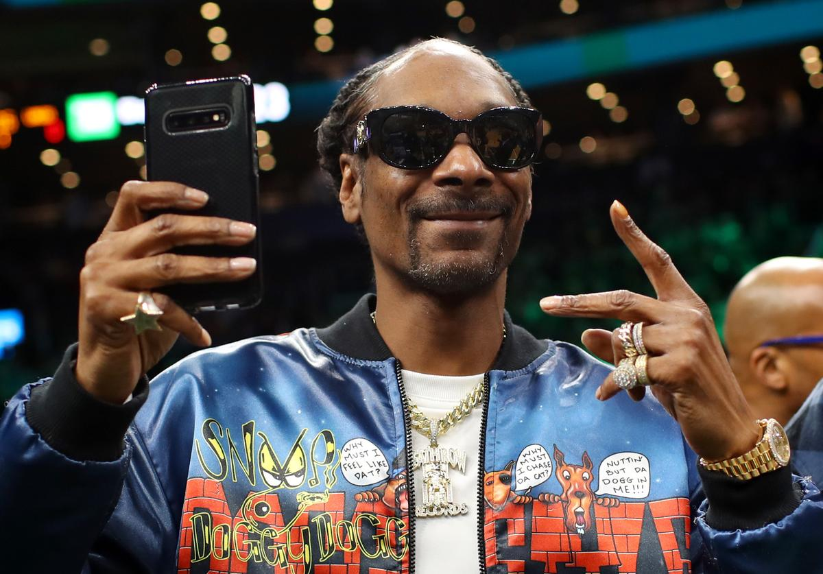 Rapper Snoop Dogg courtside before the game between the Boston Celtics and the Los Angeles Lakers at TD Garden on January 20, 2020 in Boston, Massachusetts.