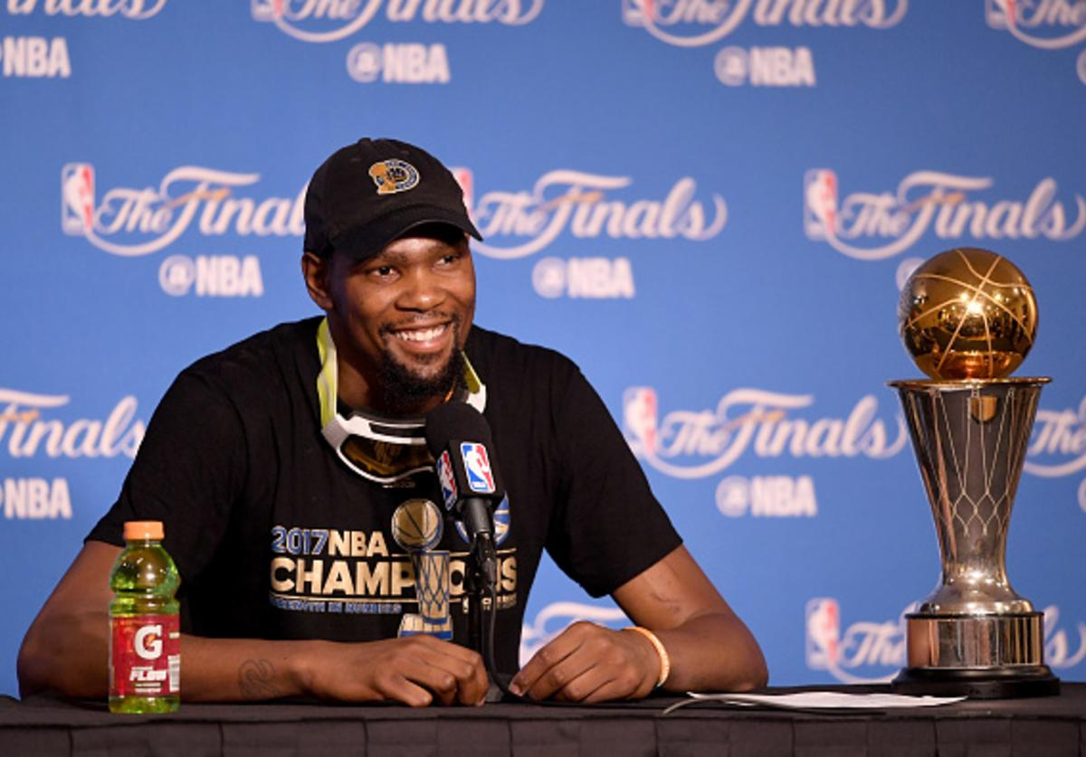 KD with his NBA Finals MVP Award