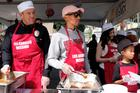 Pharrell & Son Rocket Serve Hot Meals To Those Less Fortunate For Good Friday