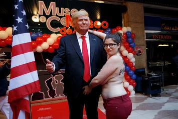 Topless Protestor Forcibly Removed After Grabbing Trump Statue By The Balls