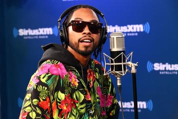 "Watch Miguel Perform ""Sky Walker"" In A Parachute"
