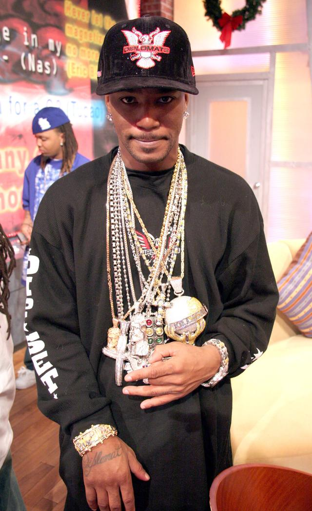 Cam'ron wearing his moving globe chain