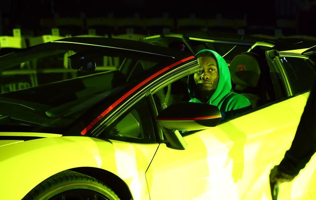 Offset sitting in a yellow car