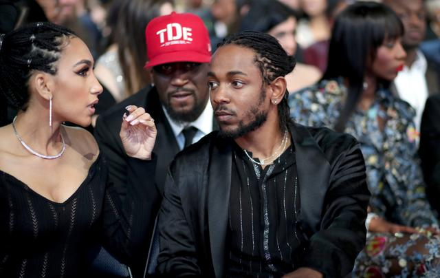Kendrick Lamar at the Grammys with his girlfriend