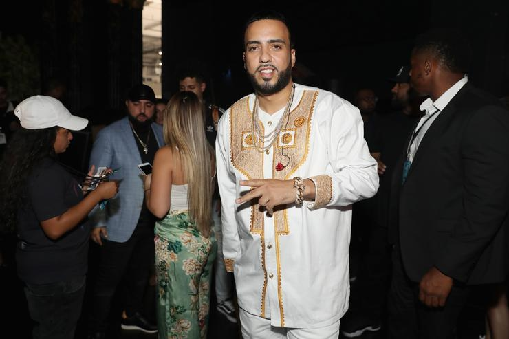 French Montana gives the peace sign