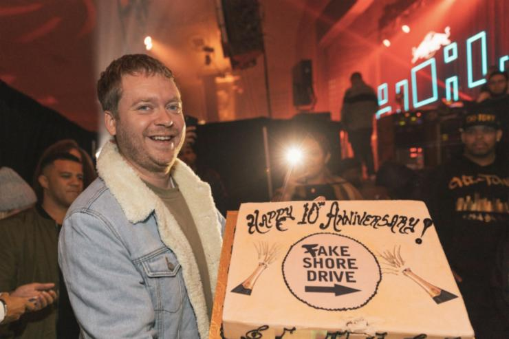 Andrew Barber with a Fakeshoredrive 10-year anniversary cake