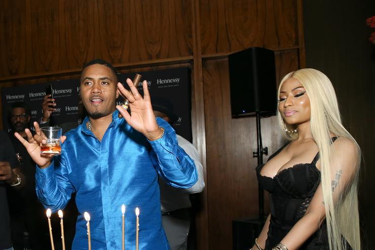 Nicki Minaj and Nas with a birthday cake