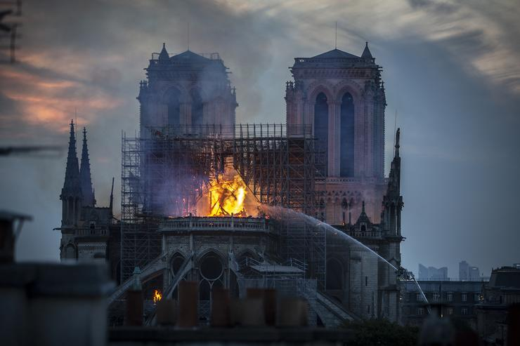 Paris France. A fire broke out on Monday afternoon and quickly spread across the building collapsing the spire. The cause is yet unknown but officials said it was possibly linked to