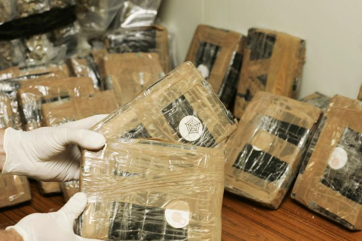 Confiscated bags containing cocaine are displayed at the Brussels Federal Police station on April 24, 2007 in the Belgian capital Brussels