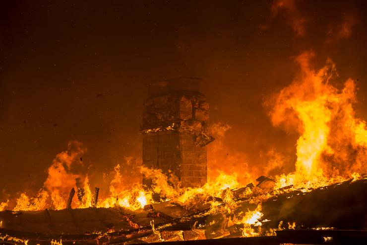 A house burns during the Woolsey Fire on November 9, 2018 in Malibu, Californi