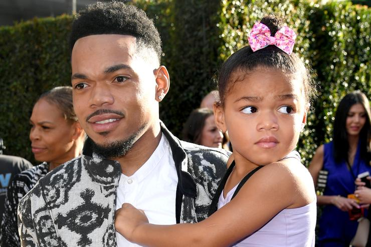 Chance the Rapper and his daughter at the Lion King premiere