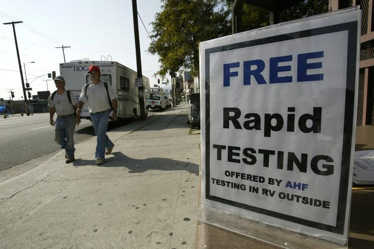 A motorhome converted into a mobile HIV screening lab by the AIDS Healthcare Foundation (AHF) is parked on a busy street on its first day of operations on April 28, 2004 in Los Angeles, California