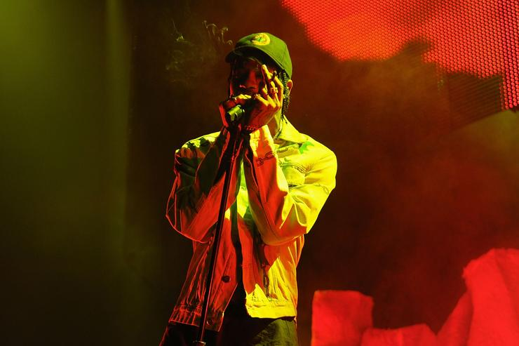 "Travi$ Scott performing at The Weeknd's ""Madness"" show in Brooklyn"