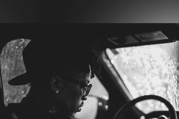 August Alsina in car driver seat