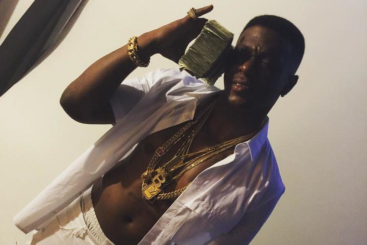 Boosie holding cash money
