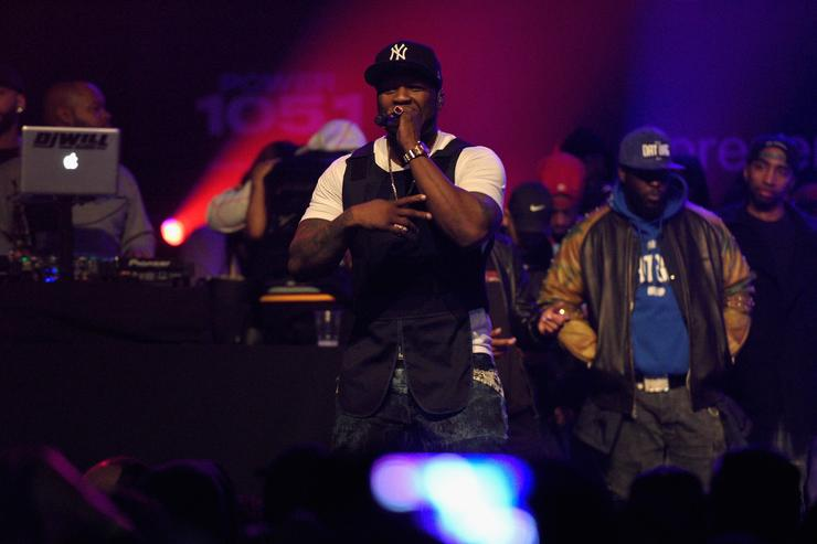 50 Cent performs on stage at Breakfast Club Event