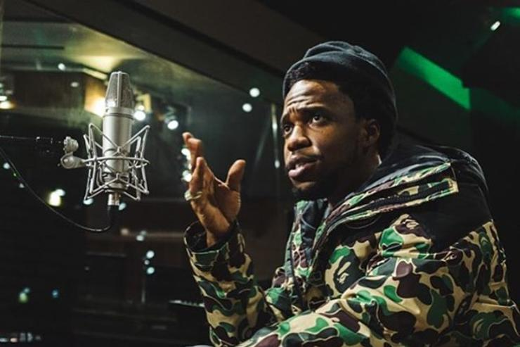 Currensy behind the studio mic