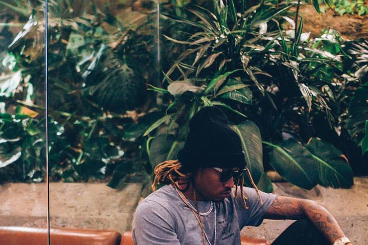 Future sitting on a couch