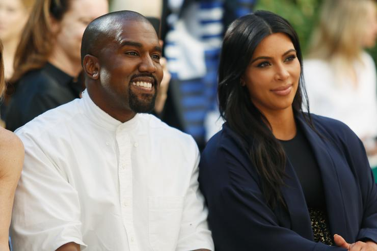 Recording artist Kanye West (L) and TV personality Kim Kardashian attend CFDA/Vogue Fashion Fund Show and Tea at Chateau Marmont