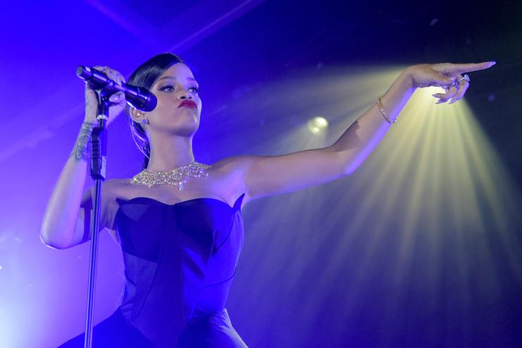 Recording artist Rihanna performs onstage at The Inaugural Diamond Ball presented by Rihanna and The Clara Lionel Foundation at The Vineyard on December 11, 2014 in Beverly Hills, California